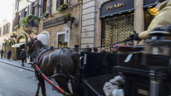 Rome, Italy - January 1, 2017: Carriage with horse carrying tourists on Via Condotti  in Rome, Italy, one of the most exclusives streets in Europe